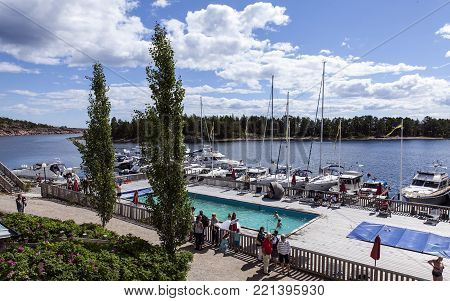 ULVON, SWEDEN ON JULY 18. View of the pool and marina close to Ulvo Hotel on July 18, 2017 in Ulvon, High Coast Heritage, Sweden. Unidentified people. Editorial use.