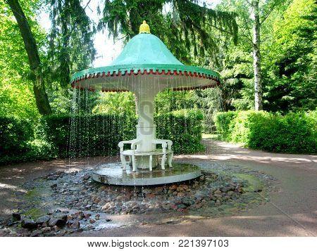 Petergof, Saint peterburg, Russia - JUNE 12, 2013: Mushroom fountain surrounded by stones in the park of the Peterhof