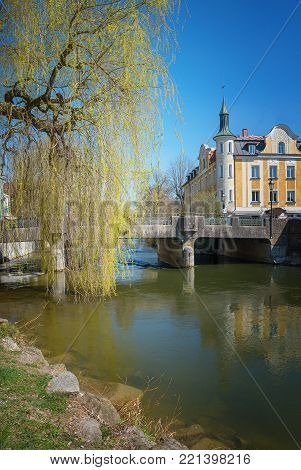 historic building and bridge over amper river, old town furstenfeldbruck, district of munich