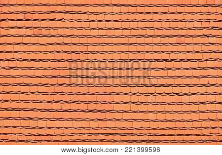 Traditional red brown ceramic roof tiles pattern background, close up, low angle side view