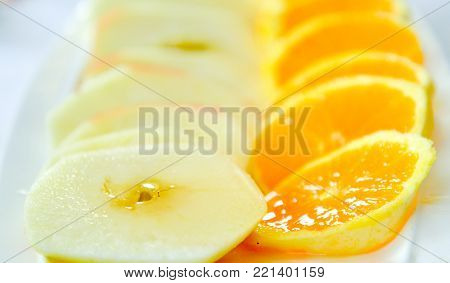 Fresh Oranges an Apples with honey, shallow dof, image of a