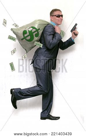 Robber man is running away from bank with money bag and pistol in hands isolated on white background. Financial fraud.