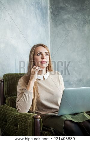 Cute Young Woman Using Laptop and Surfing the Web at Home