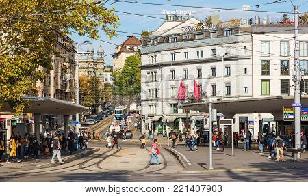 Zurich, Switzerland - 29 September, 2017: tram stops, people and buildings on Bellevueplatz square. Bellevueplatz is a town square in Zurich, named after the former Grandhotel Bellevue on its north side.