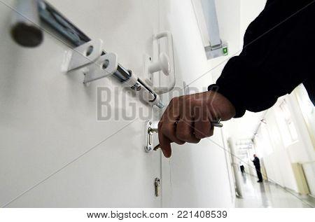 White Prison interior, guard locking prison door