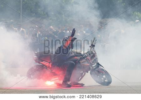 Bucharest, Romania - May 24, 2014: Narcis Roca performing a stunt motorcycle show at Iubim 2 Roti festival organized by Free Riders motorcycle club