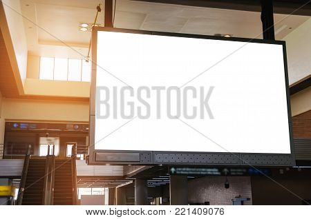 big lcd tv screen, blank advertising billboard or light box showcase at airport or subway train station, copy space for your text message or media content, advertisement, commercial, marketing concept