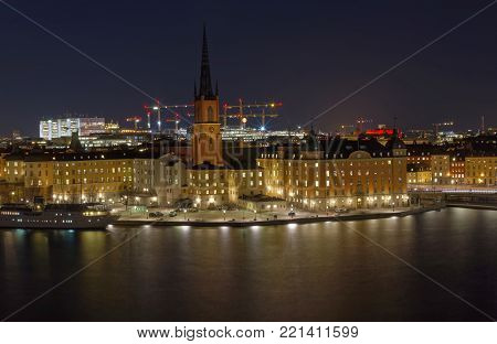 STOCKHOLM - SWEDEN, JAN 08 2017: The medieval Church Riddarholmskyrkan built 1300, during evening/night in central Stockholm, January 08, 2017