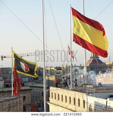 Birgu city, Malta - 8 april 2017: flags on  traditional religion feast in Birgu, Malta. Traditional maltese flags
