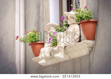 windowsill statues of childrens background with flowerpots balcony window sill poster