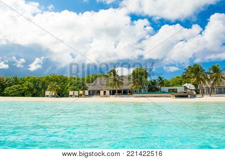 South Ari Atoll, Maldives - 12 July 2017: Beautiful tropical landscape luxury resort beach and crystal turquoise water of the Indian Ocean, Maldives island, 12 July 2017