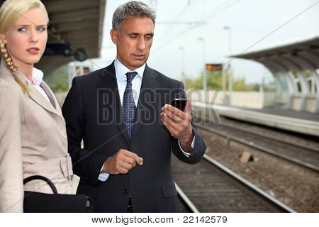 Business couple waiting for a train