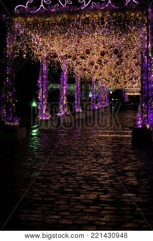 Decorated by the led lights and balls passage and its reflection on cobblestone pavement, Moscow, Russia