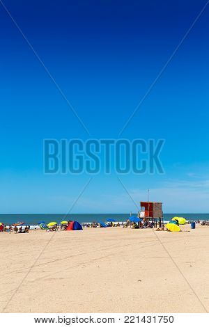 Skyline. View of a beautiful beach in a sunny day of summer. The sky is intense blue. Minimalist composition.