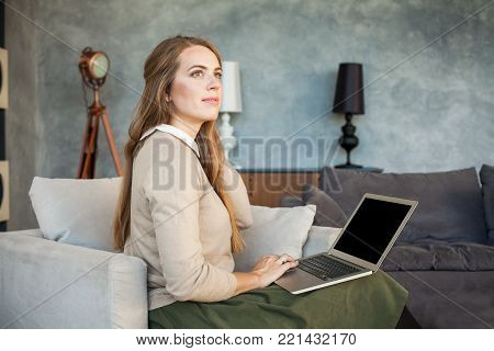 Cheerful Woman Using Laptop. Surfing the Web, Internet Shopping or Social Media Concept.