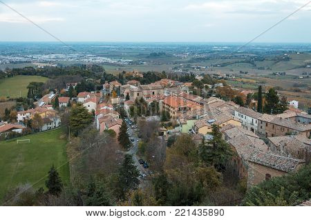 Small italian town Bertinoro, surrounded by vineyards, meadows, zone of production of traditional italian red wine Sangiovese