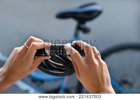 Combination Bike Lock In Female Hands