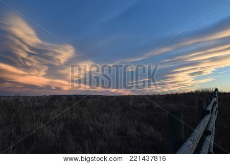 Fence Line with Prairies Landscapes in Winter