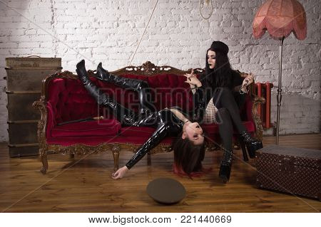 The Woman In Uniform Strangles The Second Woman With A Chain From The Handcuffs