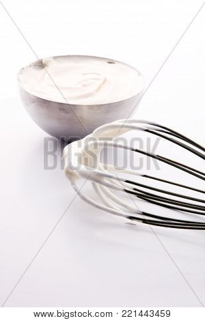 close up of a white whipped or sour cream in bowl