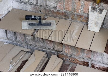 A Workplace For A Master From Laying Tiles. Tools And Accessories As Well As Tiles When Laying.