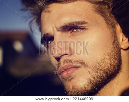 Headshot of one handsome young man in urban setting