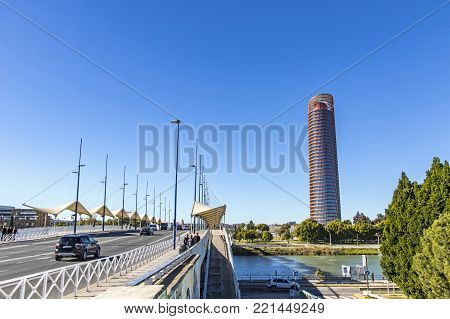 SEVILLE, SPAIN - DECEMBER 16, 2017: City skyline view with Sevilla Tower on the background (Spanish: Torre Sevilla). Office skyscraper in Seville, Spain. Tallest building in Andalusia province