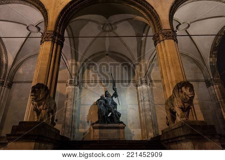 Feldherrnhalle monument with its typical lion statues at night in Munich, Germany. The Feldherrnhalle is a monumental loggia on the Odeonsplatz