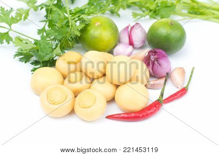 whole champignon mushrooms in brine and vegetable  isolated on white background