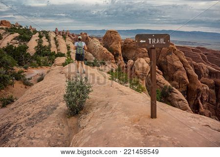 Woman Hikes Down Slick Rock Trail in Arches National Park