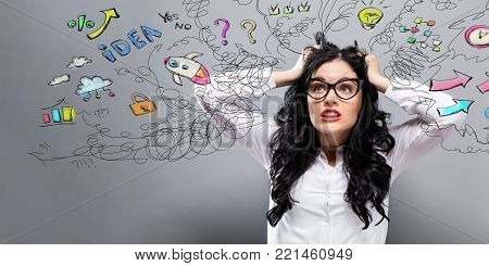 Unhappy woman with many thoughts on a gray background