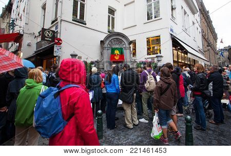 Brussels, Belgium - June 18, 2011: Tourists waiting to see Manneken Pis: changing of the clothes
