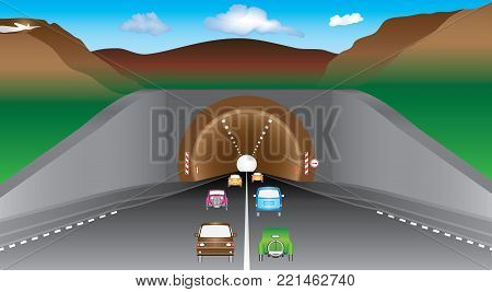 Tunnel in mountains. Highway and cars before an tunnel. Two lanes road and various vehicles, mountains and tunnel. Autobahn exit from underground mountain tunnel. Average car traffic on the highway