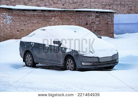 Parked cars covered with snow. Car under the snow