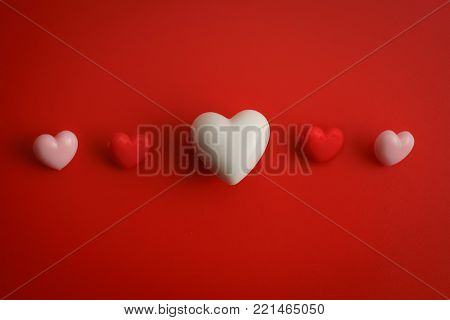 Flat view of blank notepads with valentines hearts and decoration on pink background with copy space. Symbol of love. Happy Valentines Day background.Saint Valentine's Day concept. Can be used for celebrations valentines day.