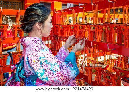Kyoto,japan - November 17 : Asian Women Wearing Japanese Traditional Kimono Visiting The Beautiful I