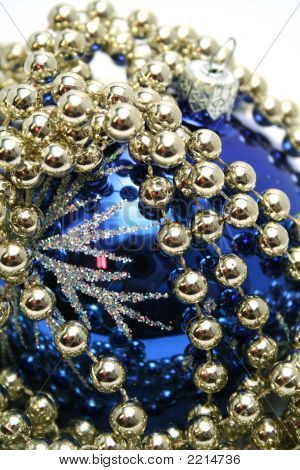 Blue Glass Sphere And Celebratory Beads On A White