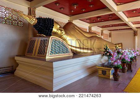 Golden buddha statue at Pha Tak Sue temple, Nongkhai, Thailand