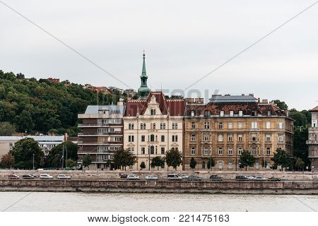 Budapest, Hungary - August 12, 2017: Cityscape of Buda  from Pest across Danube River a cloudy day at sunset in Budapest