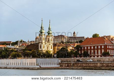 Budapest, Hungary - August 12, 2017: Cityscape of Buda with the church of saint Ann from Danube River at sunset in Budapest