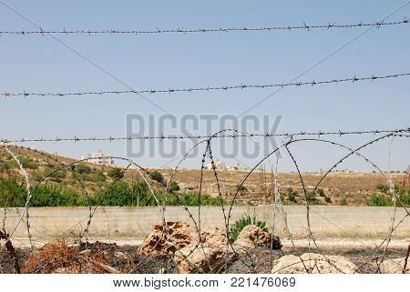 Barbed wire fence at israeli palestinian border