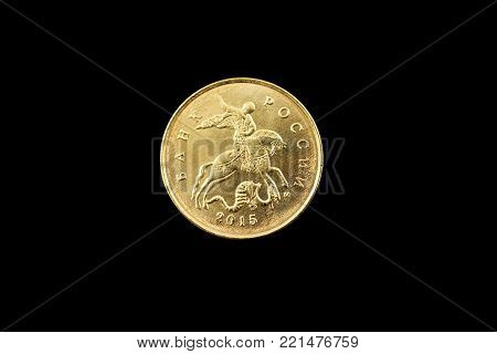 A super macro image of a silver Russian one kopeck coin isolated on a black background