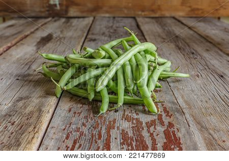 Healthy food. String beans, raw asparagus. Close-up on a wooden table.wooden background