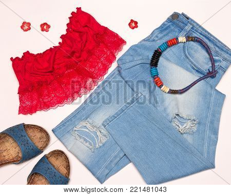 Fashion summer outfit for walk around the city. Ripped skinny jeans, bandeau crop top, necklace and sandals
