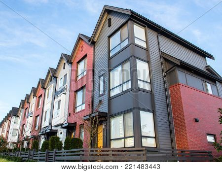 A Row Of New Real Estate Townhouses Or Condominiums.