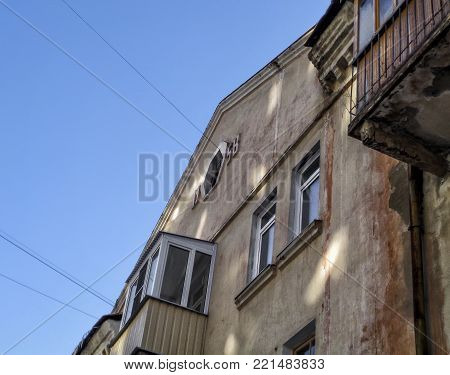 Very old apartment building reconstructed in soviet era. Old architecture. Old town