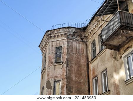 Very old apartment building reconstructed in soviet era. Bay window. Old architecture. Old town. Old building fragment