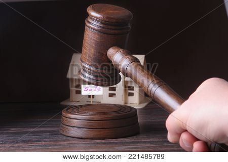 House for sale, auction hammer , symbol of authority and Miniature house . Courtroom concept