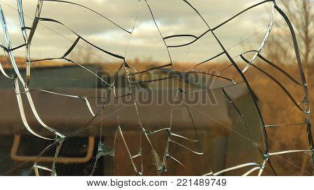 the broken glass window . shards of glass.