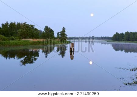 clear night, moonlight, the reflection of the moon in the pond